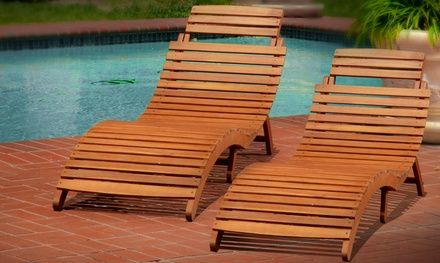 Two wooden chaise lounges complement outdoor decor and provide sun-soaked seating while tanning or relaxing during warm weather