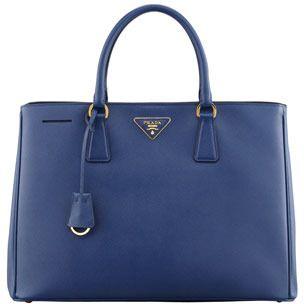 $2,200, Blue Handbag: Prada Saffiano Gardeners Tote Bag Blue. Sold by Neiman Marcus.