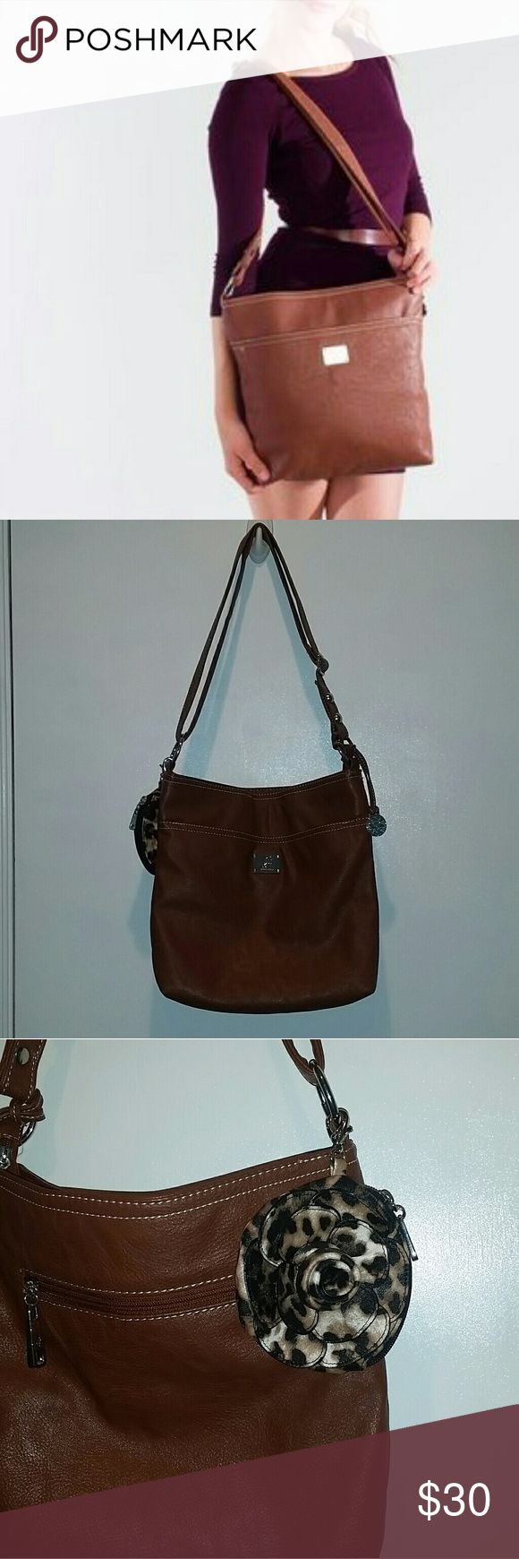 Grace Adele Crossbody Grace Adele Crossbody. Zip Closure, Zip Pocket on back, Adjustable Straps, and a magnetic pocket on front. Very Roomy. Gently Used / Excellent Condition Grace Adele Bags Crossbody Bags