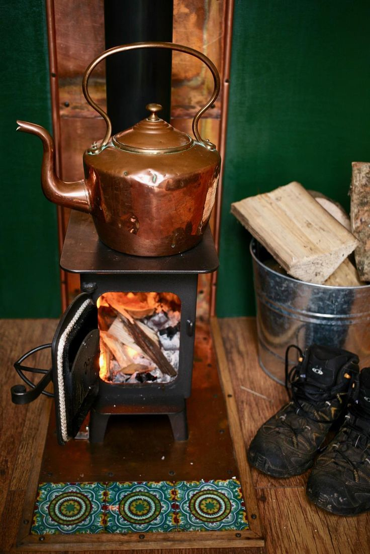 The copper backing and copper kettle, the handmade tiles, and a little spot to dry your hiking boots - this campervan woodburner is as close to perfection as you can find. You can hire Cleopatra the campervan for yourself from Devon, UK.
