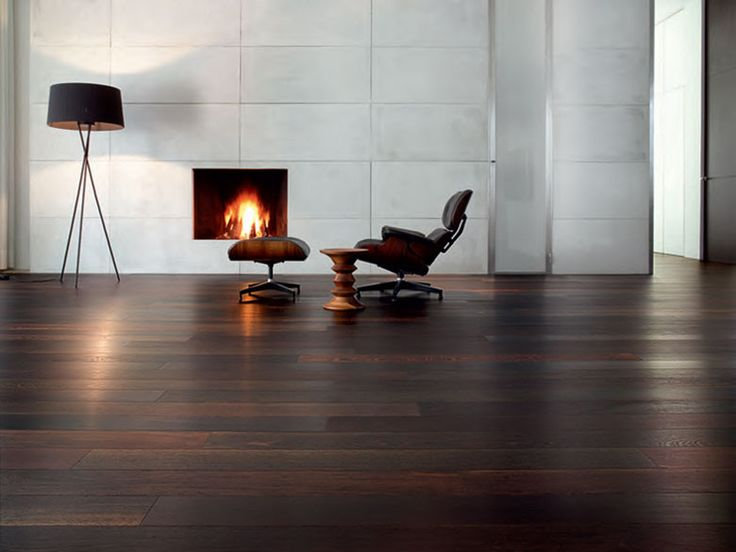 We have hardwood under the carpet so once that's exposed (hopefully it's in good shape) we will stain it dark like this