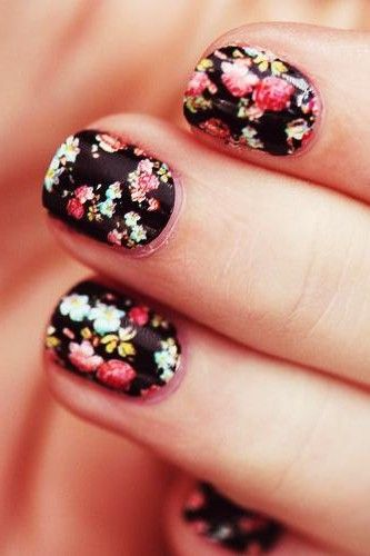 "Like the animal print, floral nails are meant to look imperfect! Grab a fine tipped brush, or tooth pick and create clusters of ""squiggly dots"" as the pros says with a few shades of the same colour."