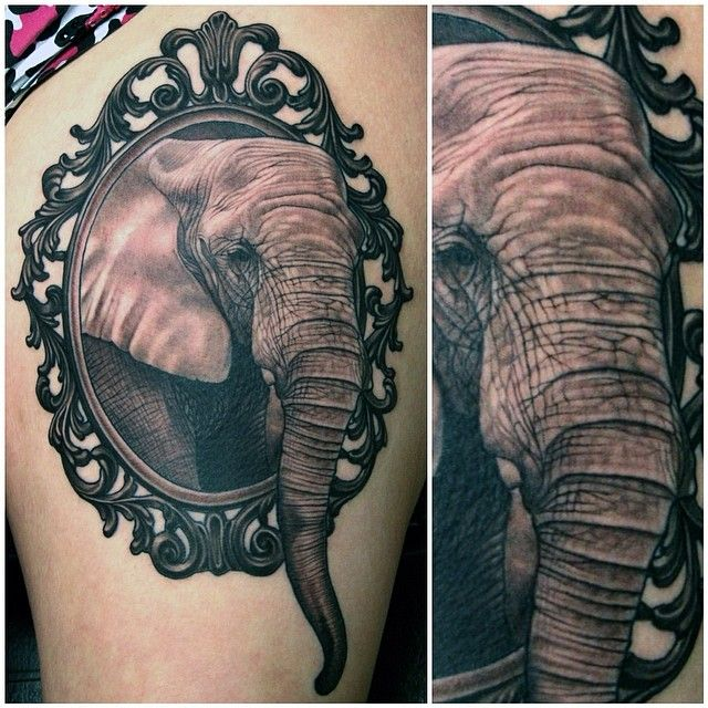 Black and grey realistic framed portrait of an elephant by Aaron Peters.