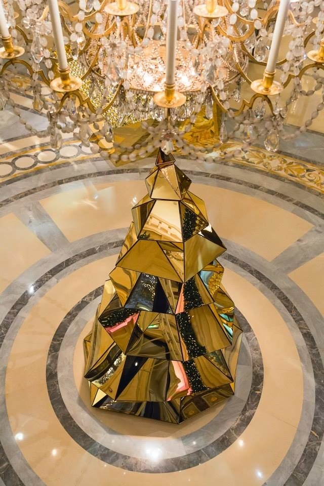 At @Mandy Dewey Seasons Hotel George V Paris, Christmas trees come in glittering gold.