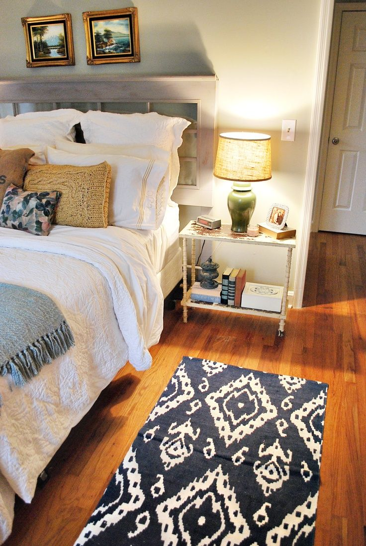 window headboard, cute and functional side table, and the ikat rug - great sleeping space.