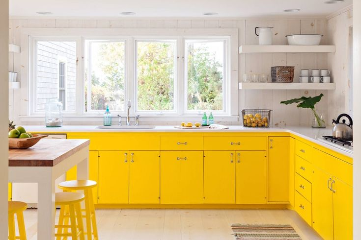 Kitchen with yellow cabinets