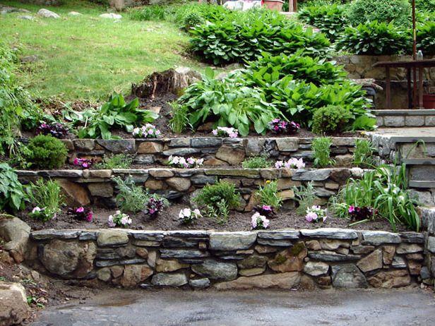 Rock Garden Patio Ideas stacked stone garden edging brown flagstone garden patio with moss rock border under construction 20 Rock Garden Ideas That Will Put Your Backyard On The Map