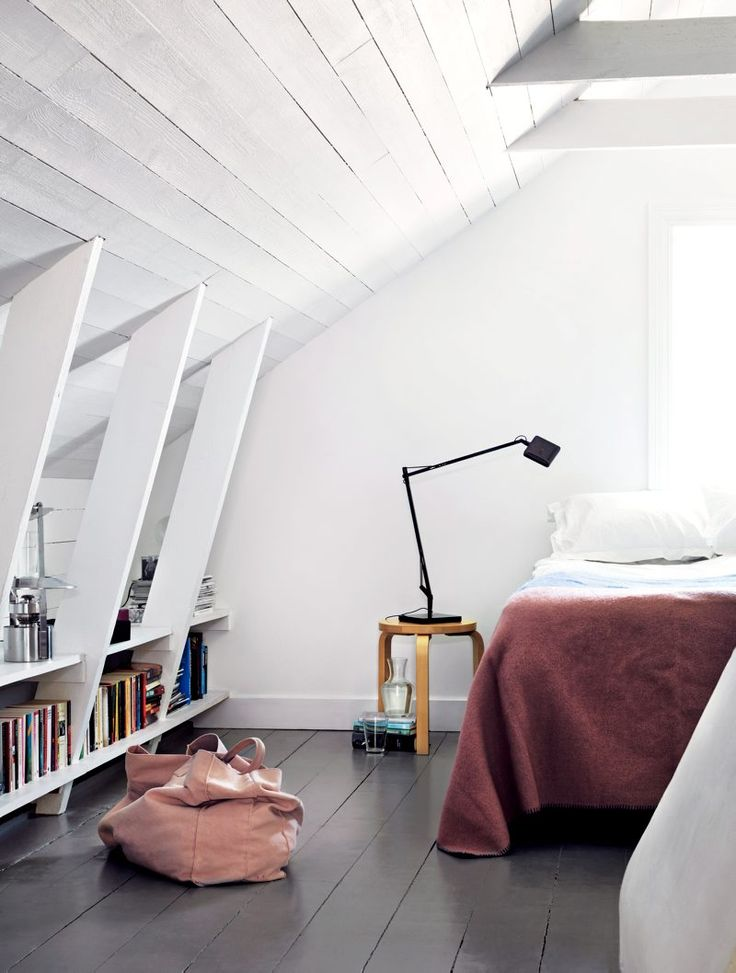 bedroom with bookshelf under the roof sloping