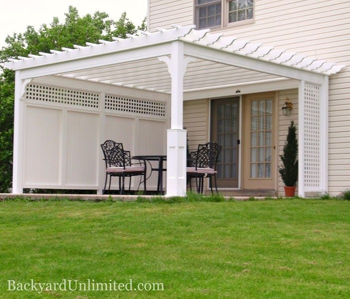 14'x14' Traditional Vinyl Pergola with Privacy Wall and Superior Posts; would provide excellent shade and privacy around the pool