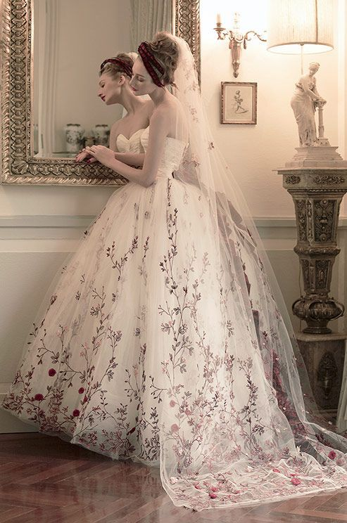 Glamorous floral embroidered ballgown wedding dress; Featured Dress: St. Pucchi