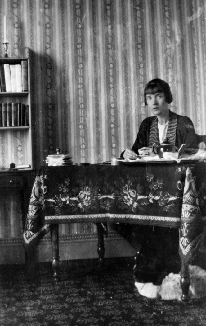 Katherine Mansfield having tea at her work table, at the Villa Isola Bella at Menton, in the south of France. (Photograph by Ida Baker, 1920)