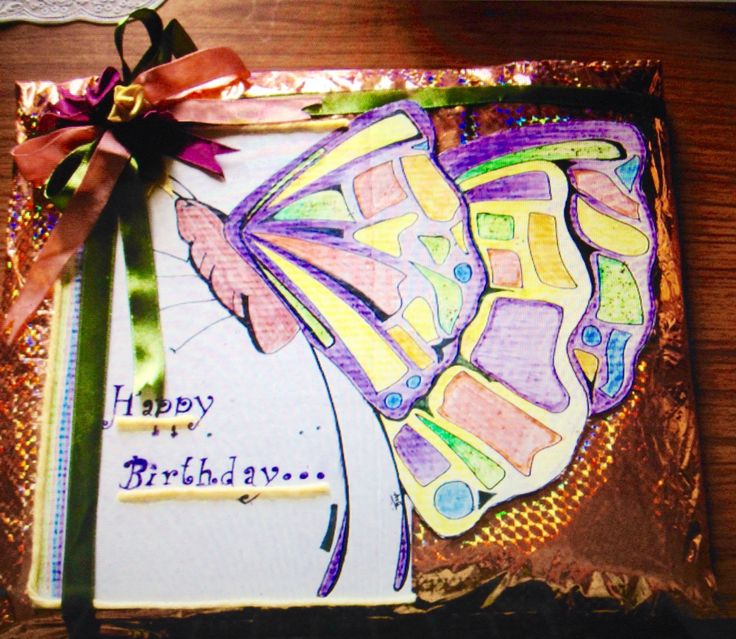 Gift wrapped and covered with a huge hand drawn butterfly and ribbon flowers!!