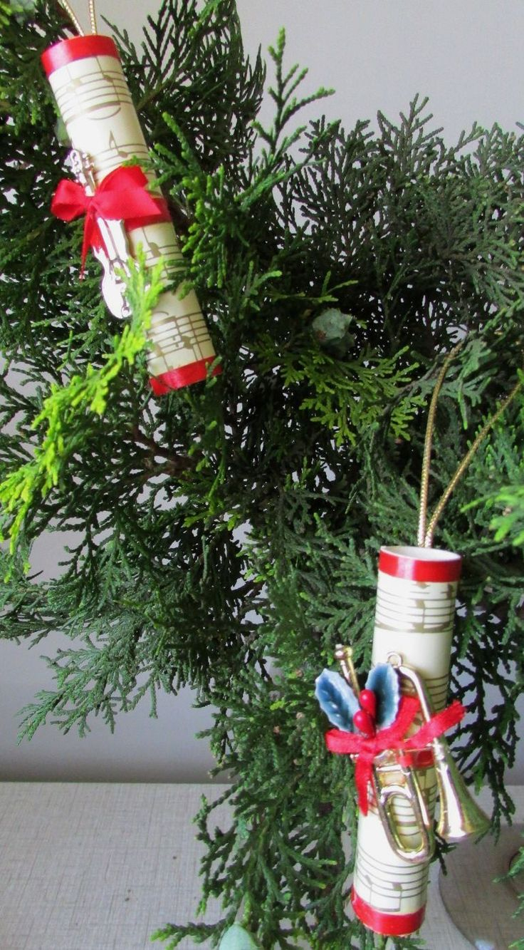 I had a sheet of Christmas wrapping paper with a music motif on it, and made these little music scroll decorations for my tree, with tiny musical instruments glued on to complete the theme.