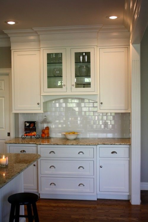 Like the way they used molding to make cabinets go to for White kitchen cabinets with crown molding