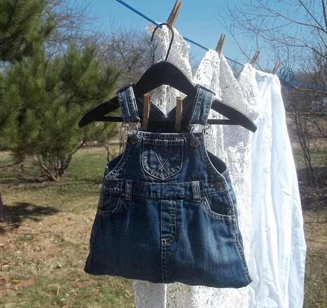 """Cute idea! She went to the clearance rack at """"BigBoxStore"""" and found a child's  overall jumper and just sewed the bottom shut, made a pretty tie to go in the waist and hung it on a child's wooden hanger, it holds a lot of pins"""