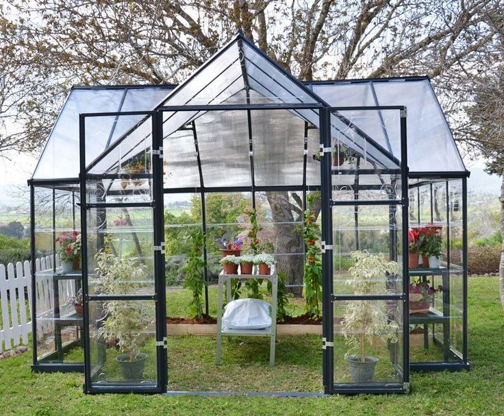 This Victory Orangery greenhouse has 101 ft² of floor space and the high vaulted ceilings allows plenty of room for trellising your tall growing plants or climbing vines. Two adjustable roof vents and