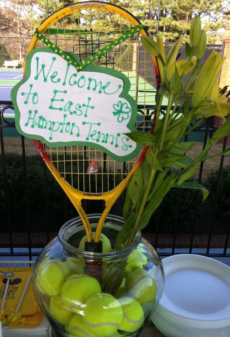 Fun tennis decoration idea.   Even if you don't use the racket, you can fill any clear vase with tennis balls and flowers.