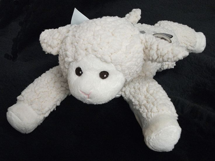 """Soft and cuddly lamb toys from Bearington Baby Collection. Lullaby Musical Lamb 11"""" tall while sitting or 14"""" lying lamb toy."""