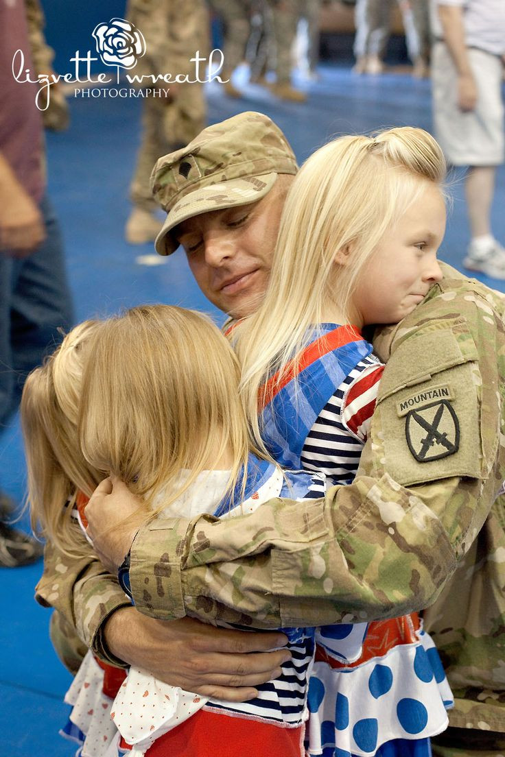 Welcome Home Daddy! First time daddy hugs his three little girls <3 so sweet!