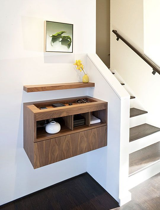 Modern entry by J. Weiss Design. It's a charging station designed by this architect. I don't need it to be a charging station, but the recessed top and shelves would be a perfect fit. Note the Heath bud vase.