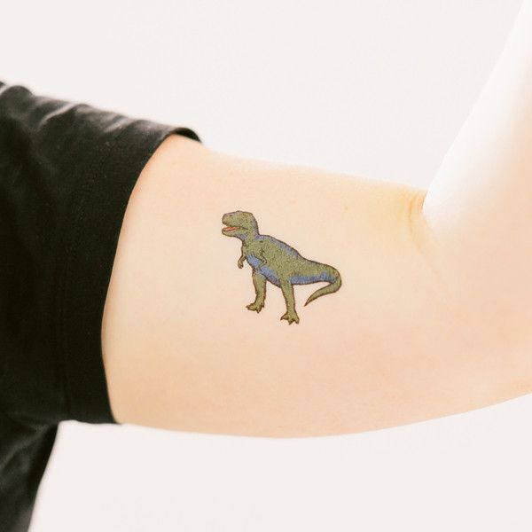 RAWR! The T Rex doesn't want to be fed, it wants to hunt. Wear T Rex by Peagreen…