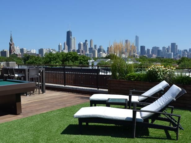 This Chicago rooftop features artificial turf, built-in benches/planters, pub seating, chaise lounge chairs and a pool table.