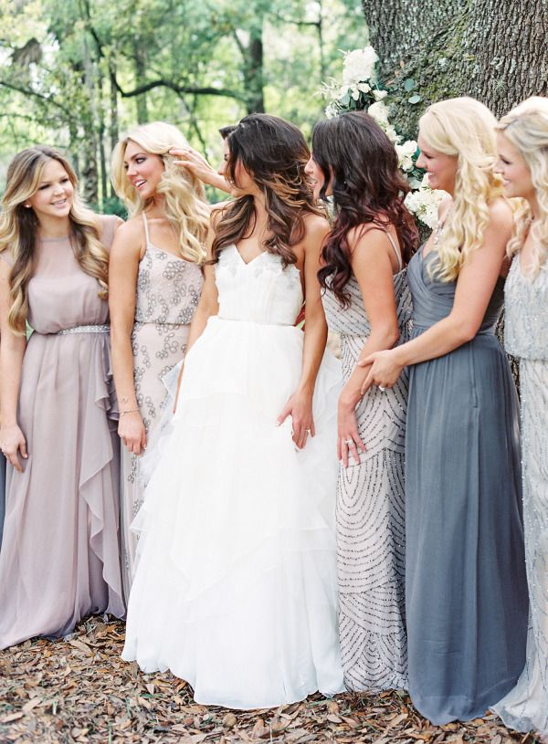 Sparkly perfection: http://www.stylemepretty.com/2015/07/27/mix-n-match-bridesmaids-dresses-youll-love/