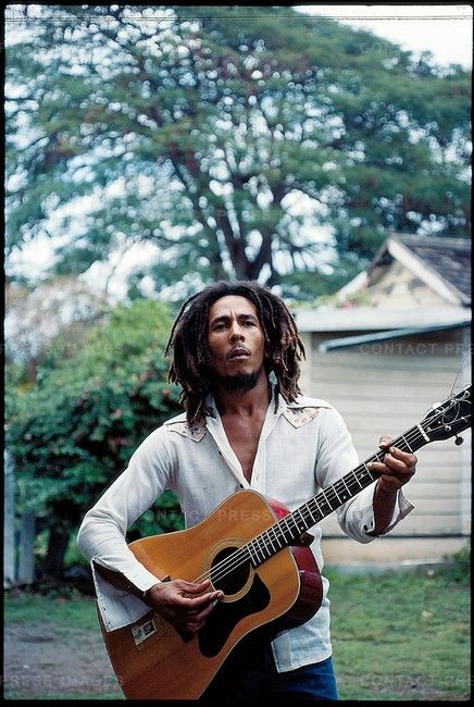 Bob Marley, with his guitar in the yard at home (Tuff Gong) in Kingston, Jamaica.   March 1976.