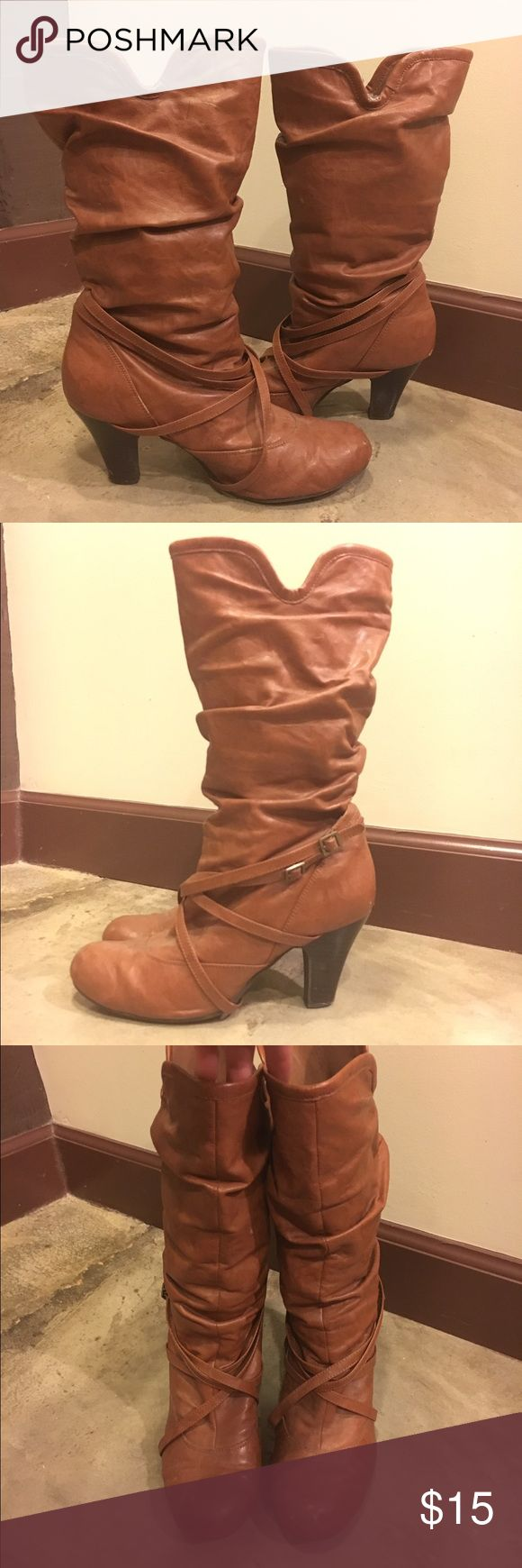 Madden girl brown heeled boots with small buckle Cute Madden girl heeled boots with wrap and buckle on side. Very comfortable and fits many sizes of calves. I would wear boot socks with them to make more scrunchy! They just slip on, no need to unbuckle. Madden Girl Shoes Heeled Boots