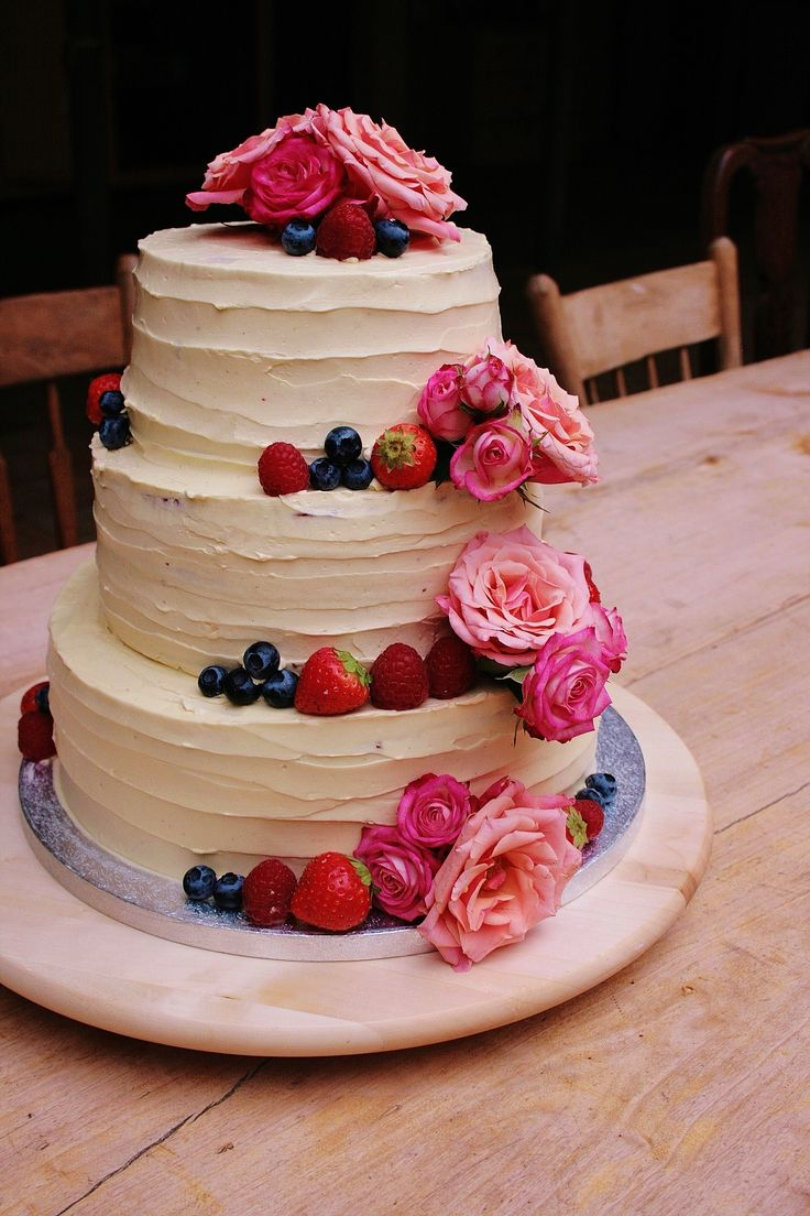 Beautifull cake with forest berries and rozes.