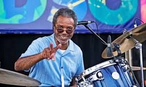 """Harold Ray Brown, born March 17, 1946, becomes a musician, a founding member of the funk band """"War."""" Harold had a number of roles over the years, acting as drummer, percussion, vocalist and band leader."""