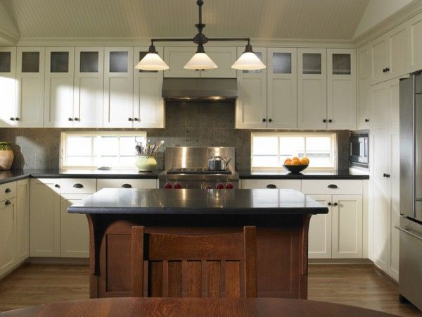 White cabinets and wood.  Like this wood tone--not too red or orange.  Also like glass at top of uppers.