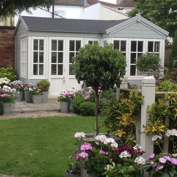 Garden Summerhouse and pots of flowers