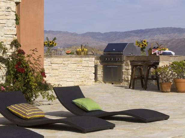 BLACK, WAVY LOUNGE CHAIRS INVITE RELAXATION IN OUTDOOR KITCHEN AREA