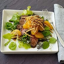 Asian Beef Salad - You'll love the variety of textures in this main-dish salad: crisp noodles, crunchy greens, juicy oranges and tender beef. 7 Weight Watchers Points!