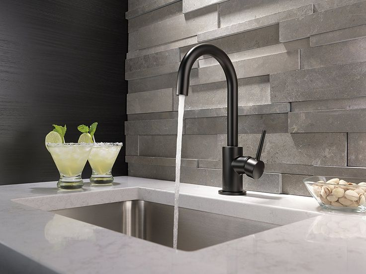 The latest kitchen trend is dark and daring. Black Faucet