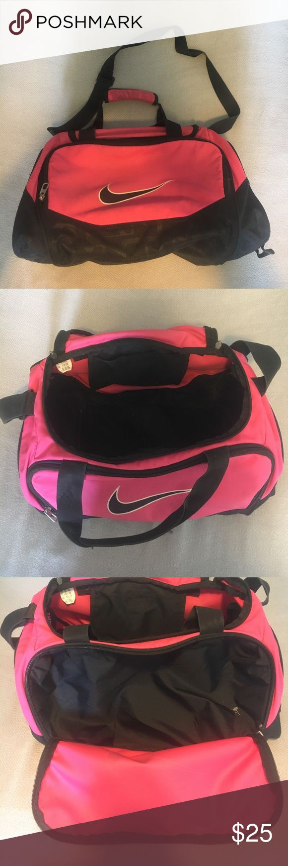 Nike Bag This hot pink nike bag has one large compartment on top, & a smaller one in the front. The large one has a small phone holder on top. It has a shoulder strap that adjusts in length, & handles if you wish to carry it. Ask any questions if needed!! I'll take offers Nike Bags Travel Bags