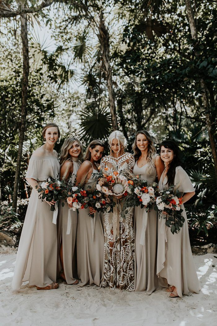 5f6244c0d46 These long and elegant neutral bridesmaids dresses were stunning at this  boho beach wedding