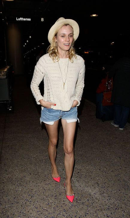 Vacation Outfit Idea: A Casual Sweater and Cutoffs, à la Diane Kruger Diane's loose-knit-and-shorts combo proves that casual doesn't have to mean boring. And those neon flats are everything.