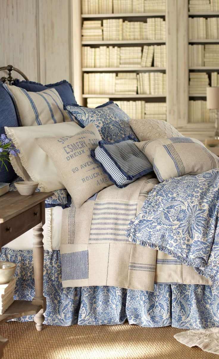 French Laundry Home #bedding looks like tea towels sewn together to make a bedspread.  Love the dust ruffle and throw to match