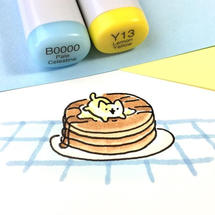Tiny butter kitty playing on a stack of pancakes
