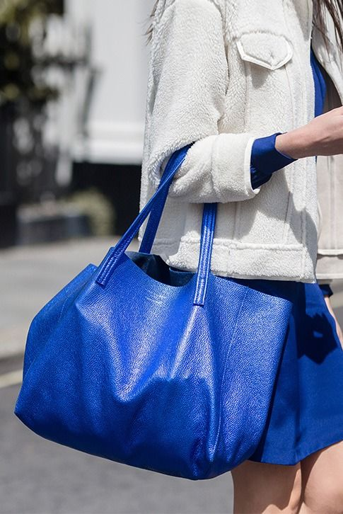 Blue Metallic Tote Bag.  Crafted in rich, supple leather with light pebbling, the Violet Horizontal Tote from Kurt Geiger London brings instant polish to your everyday accessories. Crafted in Italy, this relaxed handbag is roomy enough for even the busiest days.