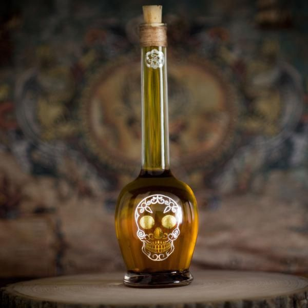Victorian themed skull bottle by ZeeCee Boutique perfect for chilli oils, potent liqueurs, Halloween potions.