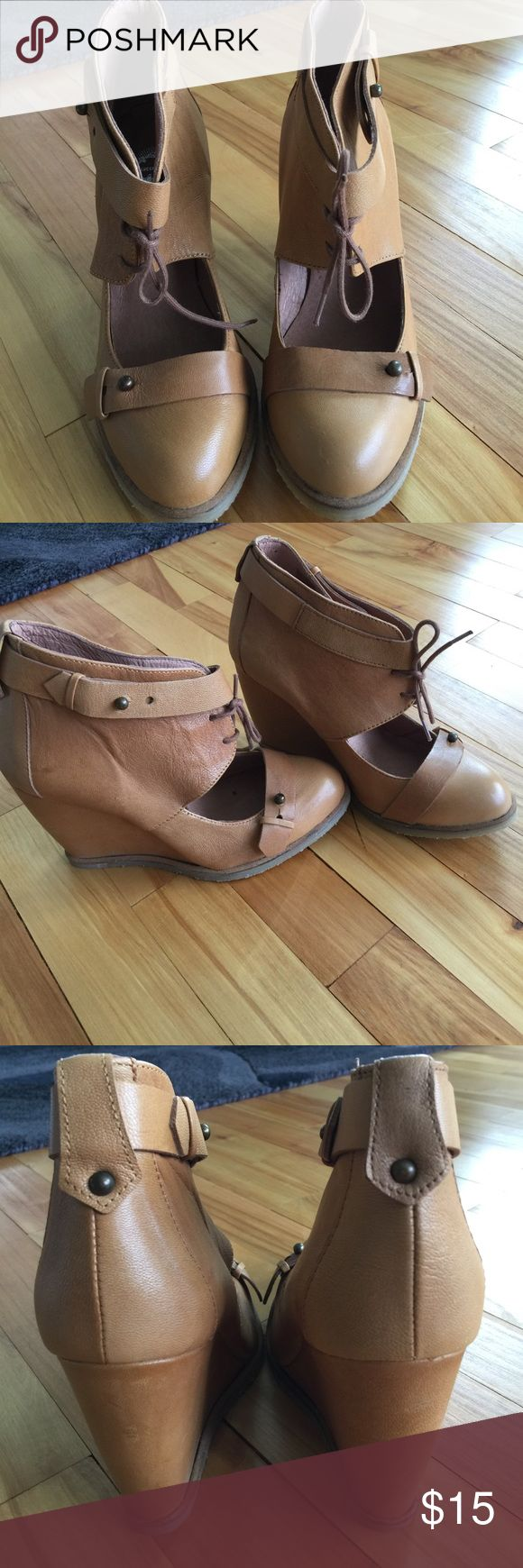 Lucky Penny tan leather ankle boot wedges, sz 7/37 Lucky Penny tan leather wedge ankle boots. Lots of style details belted band across ties match band that wraps around ankle. Cut out toe box with lace up ankle wrap. 4 inch wedges with narrow heel. Gum soles. Made in Spain. Never worn. Size 7. Nonsmoking home. Lucky Penny Shoes Ankle Boots & Booties