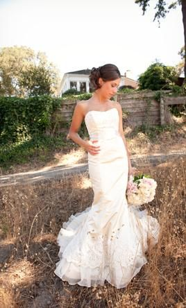 Victoria Nicole wedding gown. Love the clean lines, classic look.