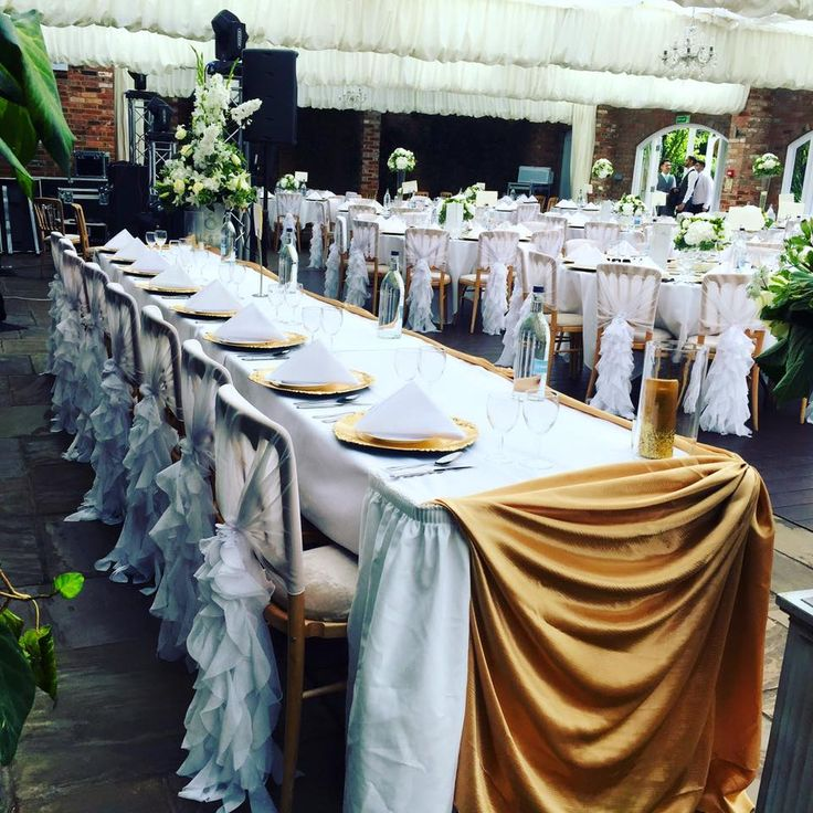 White chiffon ruffle chair hoods at Froyle Park, Hampshire. Set-up by Ellis Events - creative chair cover hire and and venue styling.