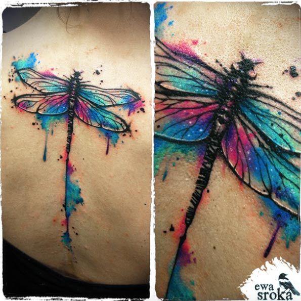 Stunning watercolor dragonfly tattoo on back by Ewa Sroka
