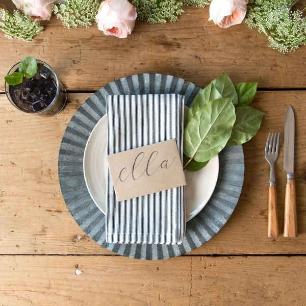 Our Pleated Zinc Chargers are the perfect touch for your table settings. The pleated zinc adds interest & texture while highlighting your plates. Order online!