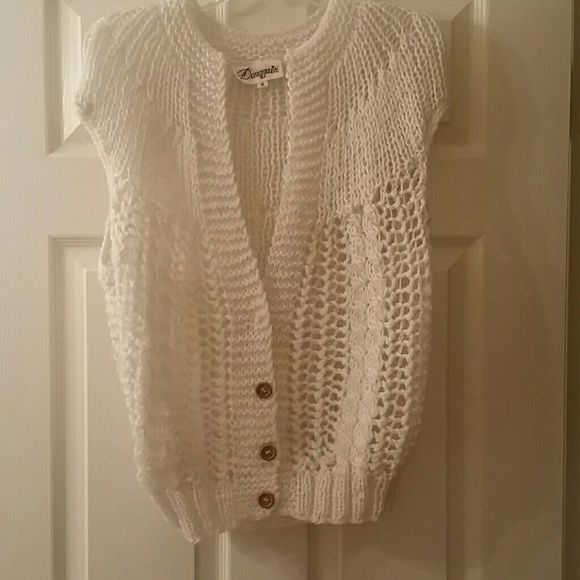 White button up sweater (never worn ) White short button up sweater,  never worn. Still in great condition. Donagain Sweaters