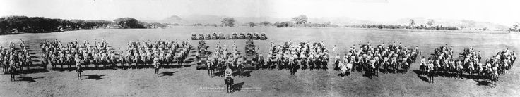 26th Cavalry Regiment, Philippines Scouts in a panoramic photograph showing the troops and armored scout cars of the regiment. At the head is Colonel Clarence A. Dougherty, commanding officer of the regiment. Most of these men later fought in the Battle of Bataan.